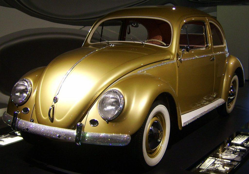 Der einmillionste VW-Käfer am 5. August 1955: ein Exportschlager der deutschen Nachkriegswirtschaft und ein Symbol des sogenannten Wirtschaftswunders.